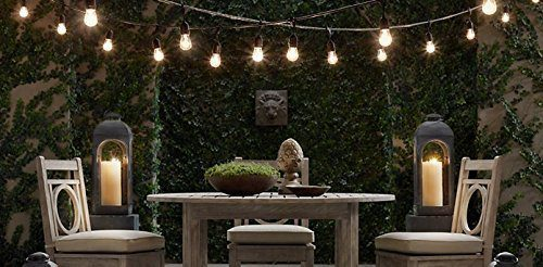 String lights draped over an outdoor table in photo from Amazon
