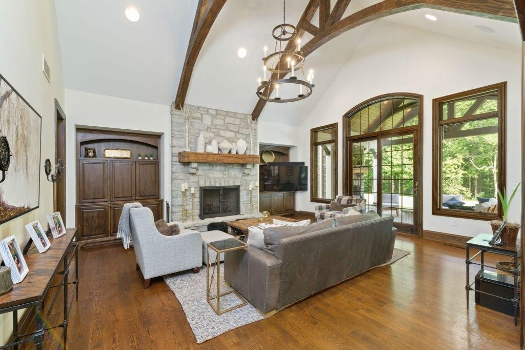 Hensley custom home Cincinnati family room with timber trusses