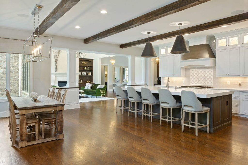 Hensley custom home kitchen with timber beams