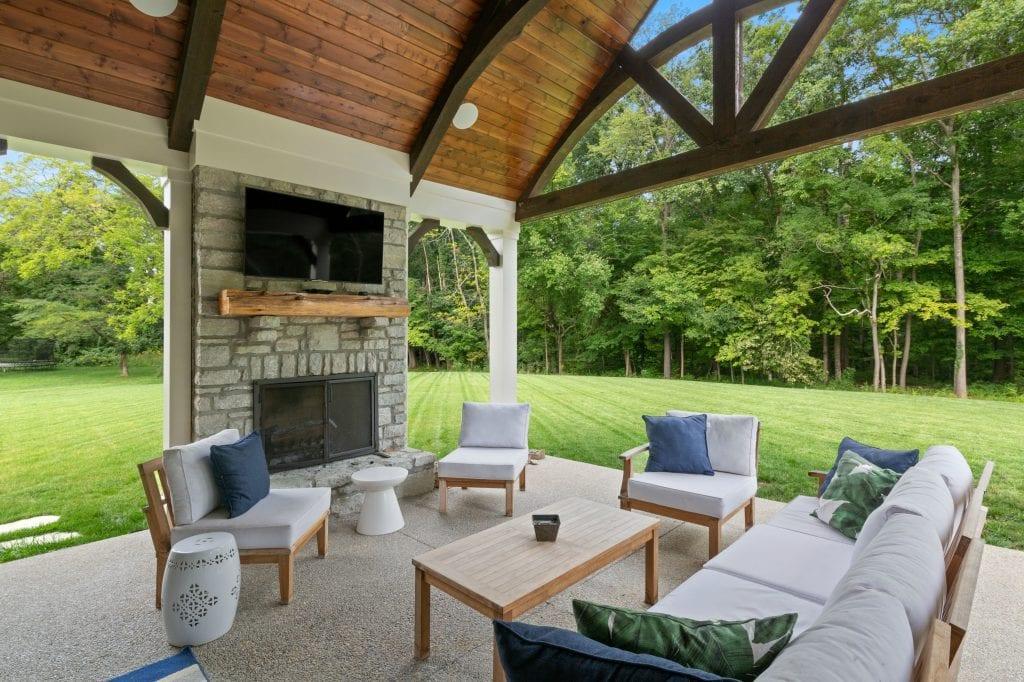 Hensley custom home Cincinnati outdoor living space with timber truss