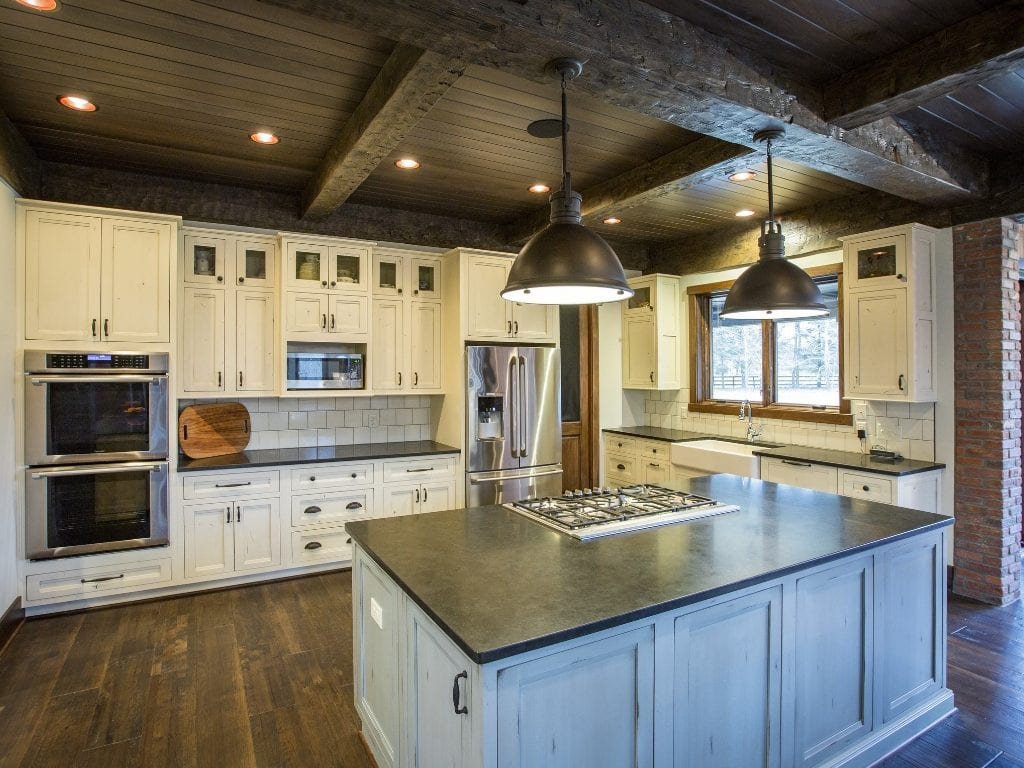 Kitchen with rustic beams in lodge style custom home Cincinnati