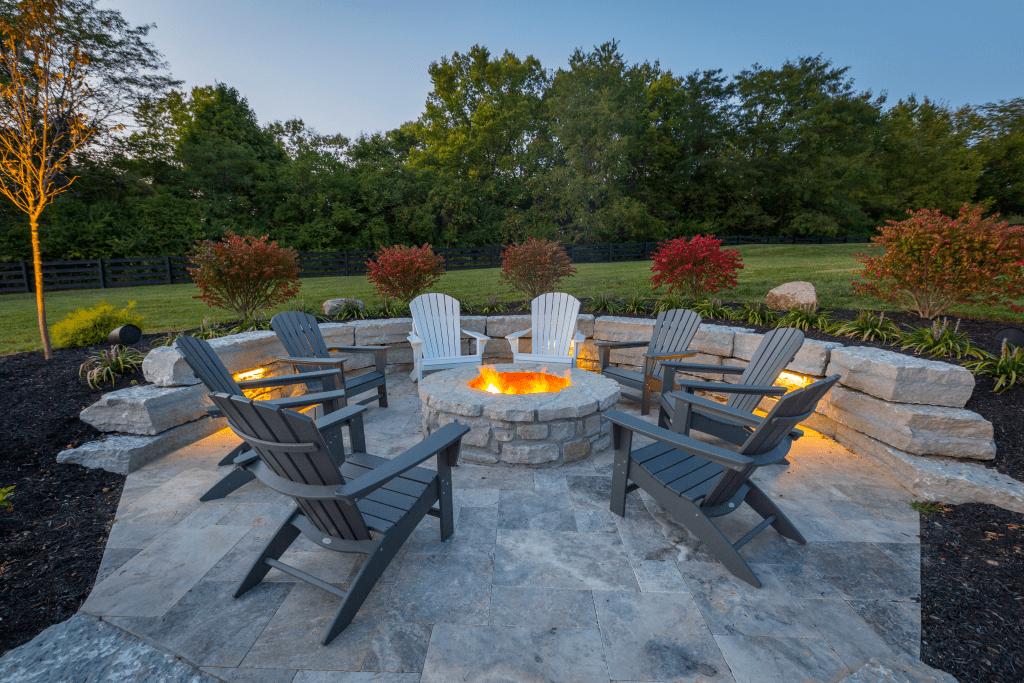 Fire pit and chairs with stone wall