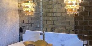 Custom home tiles in powder room new construction