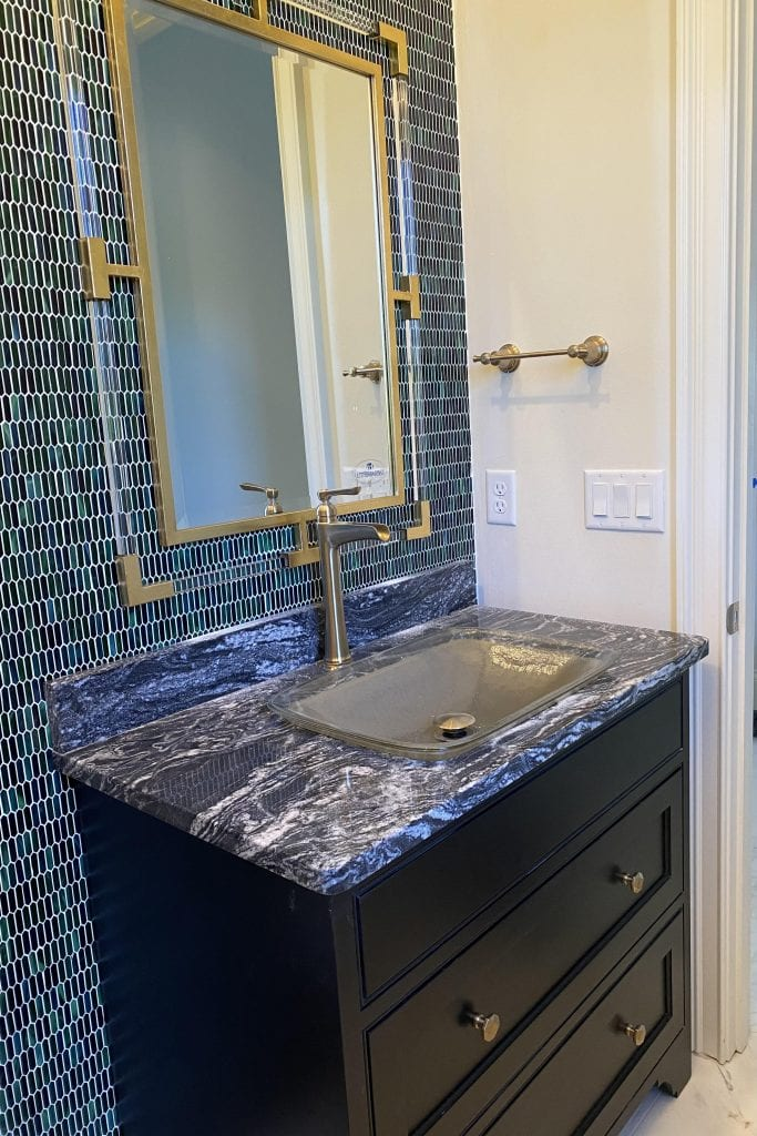 family powder room with glass mosaic tile new construction